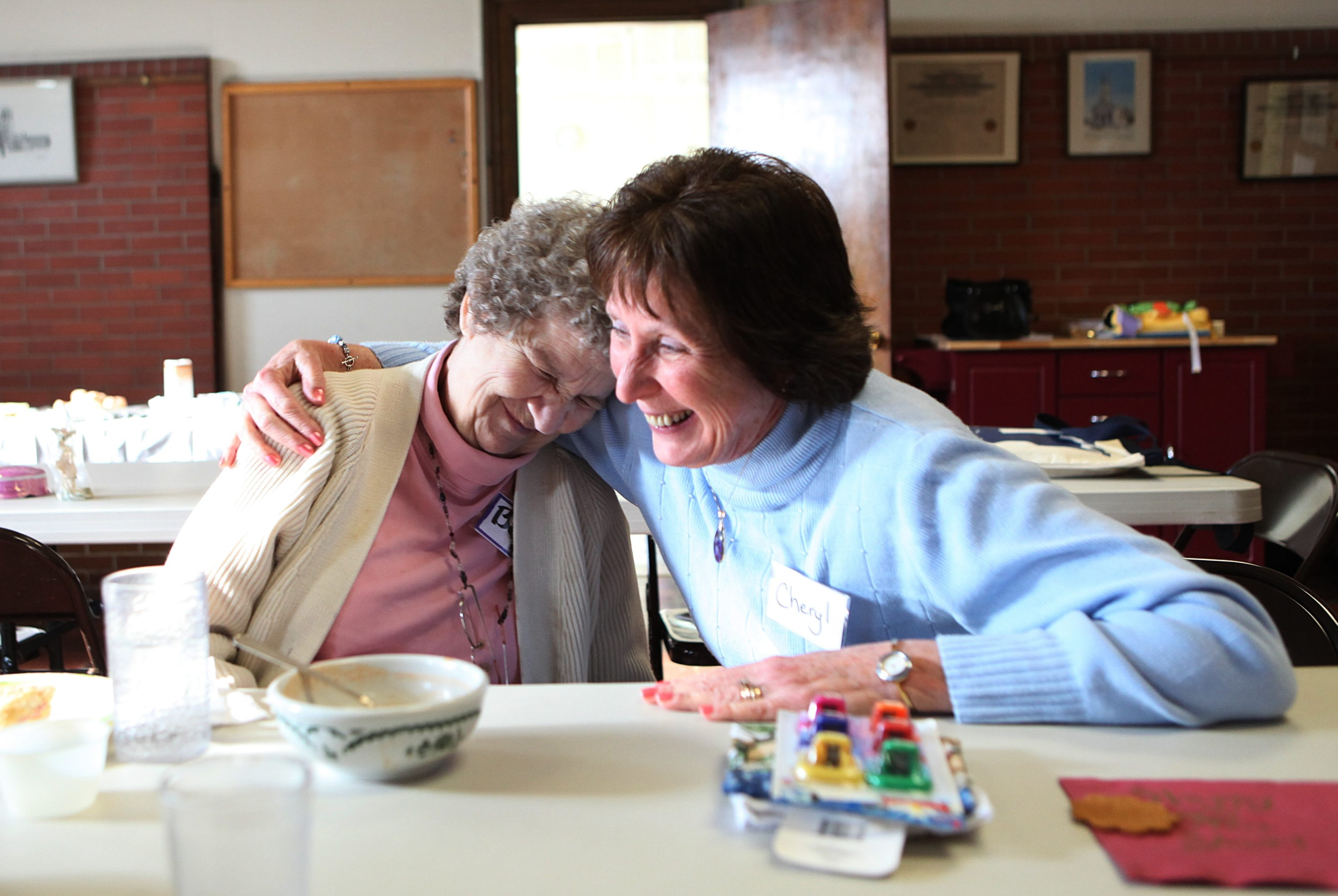 The Hamburg United Methodist Church runs a monthly respite program for caregivers of loved ones with dementia. es for four hours.   Guest Bert, left, gets a hug from volunteer Cheryl Bell as they joke around together.