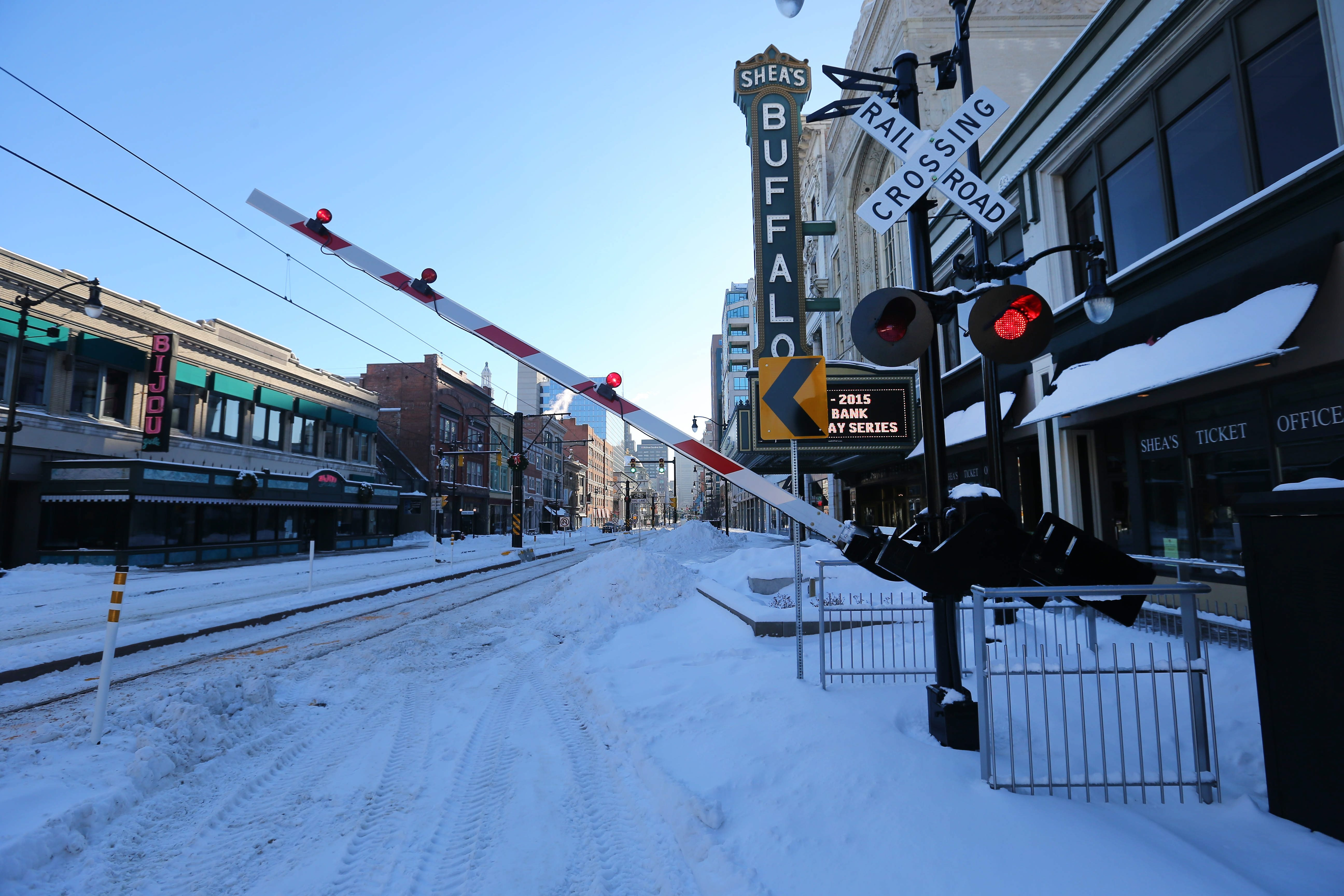 A railroad barrier will drop into place to stop vehicle traffic from entering Main Street when there is an oncoming NFTA Metro Rail train.  (Mark Mulville/Buffalo News)