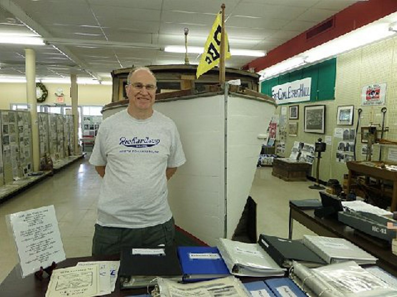 Volunteer William Bauza, a descendant of the Luke family, stands near a display table at the North Tonawanda History Museum, which has several new exhibits on display.