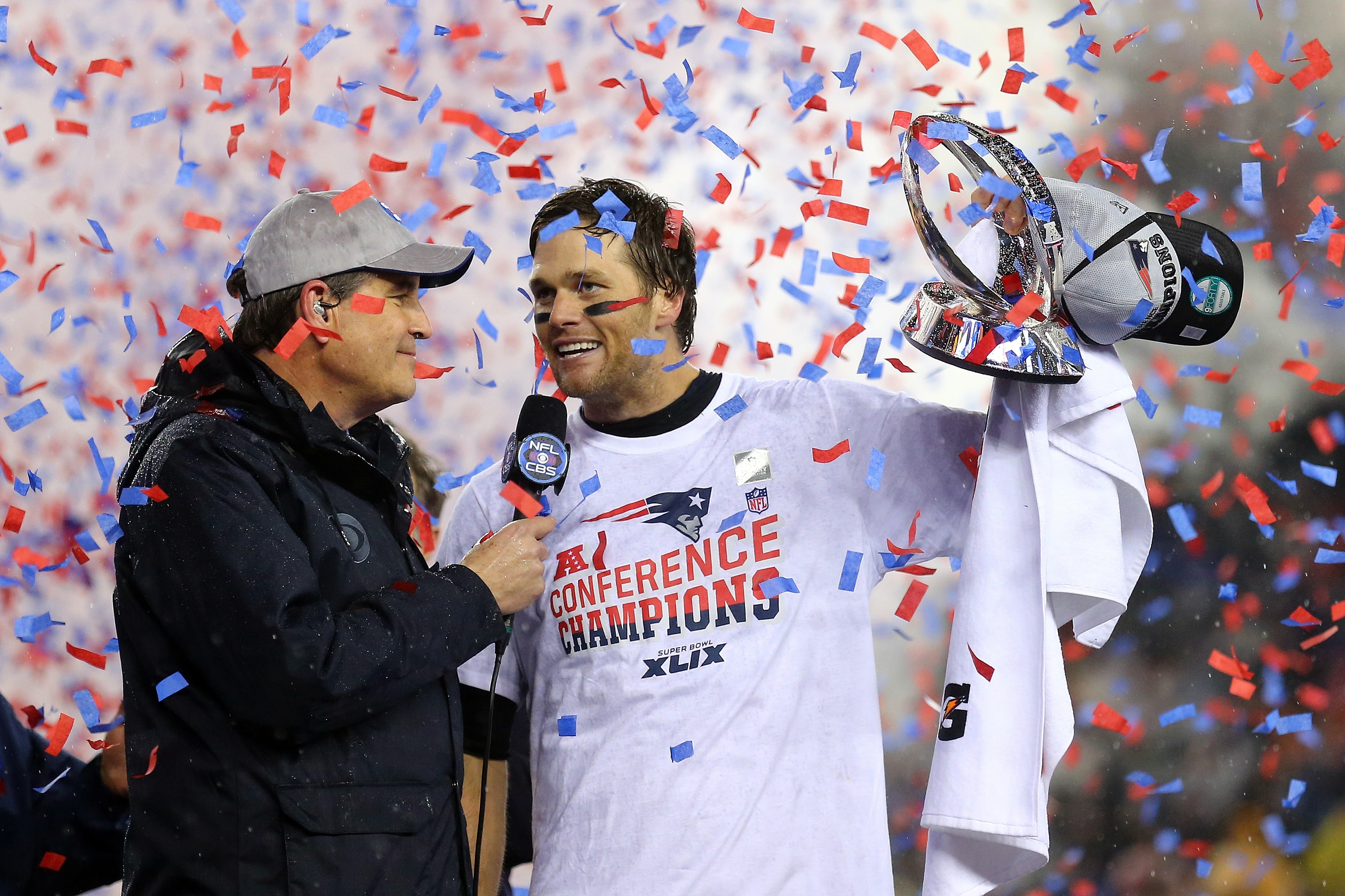 "New England quarterback Tom Brady, shown here holding up the Lamar Hunt Trophy after his team's defeat of the Indianapolis Colts in the AFC championship game Jan. 18, said he was ""shocked"" to learn some of the Patriots' footballs were underinflated."