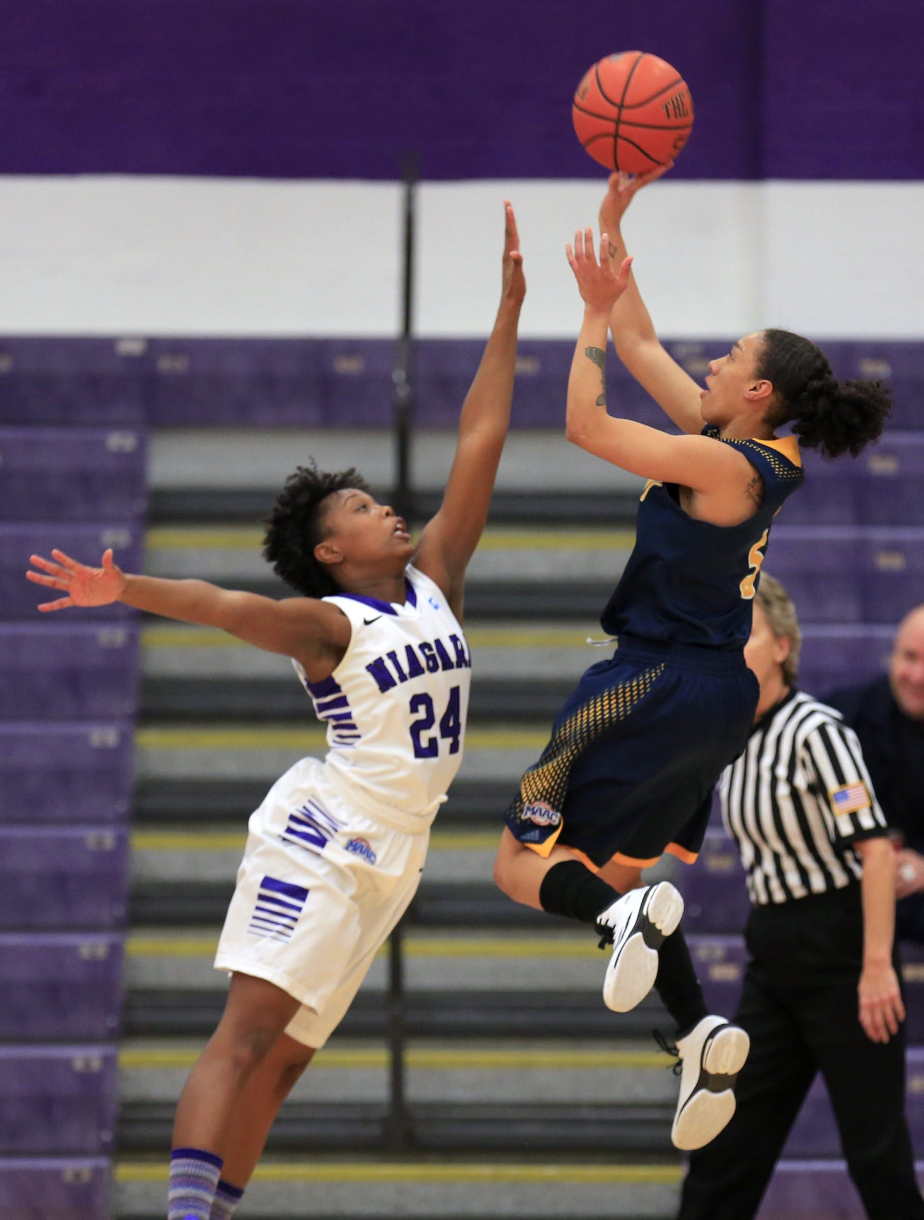 Tiahana Mills floats a one-hander for two points over Niagara's Joy Adams during the first half.