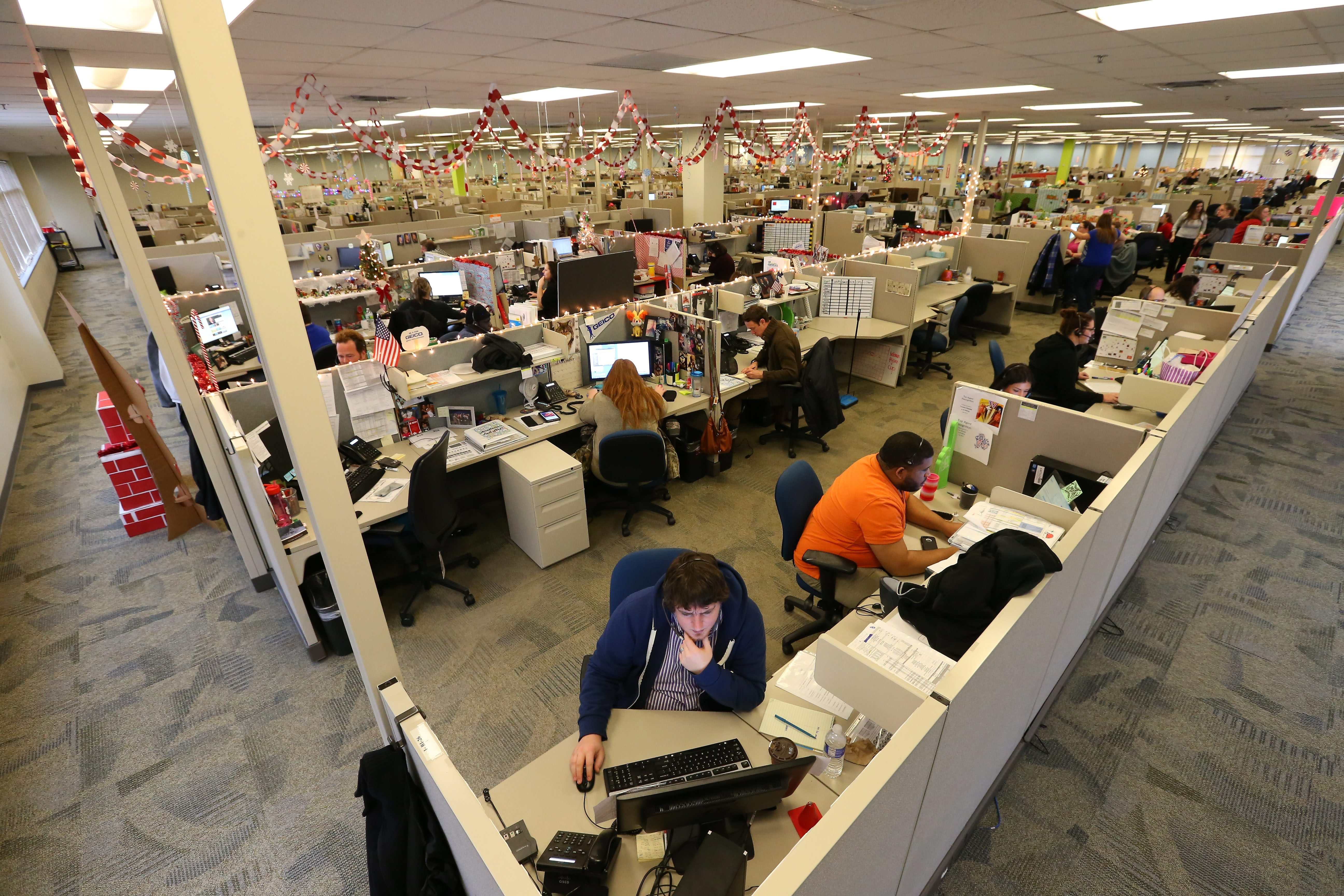 Geico employees work at the call center in Amherst Wednesday, December 10, 2014.  (Mark Mulville/Buffalo News)