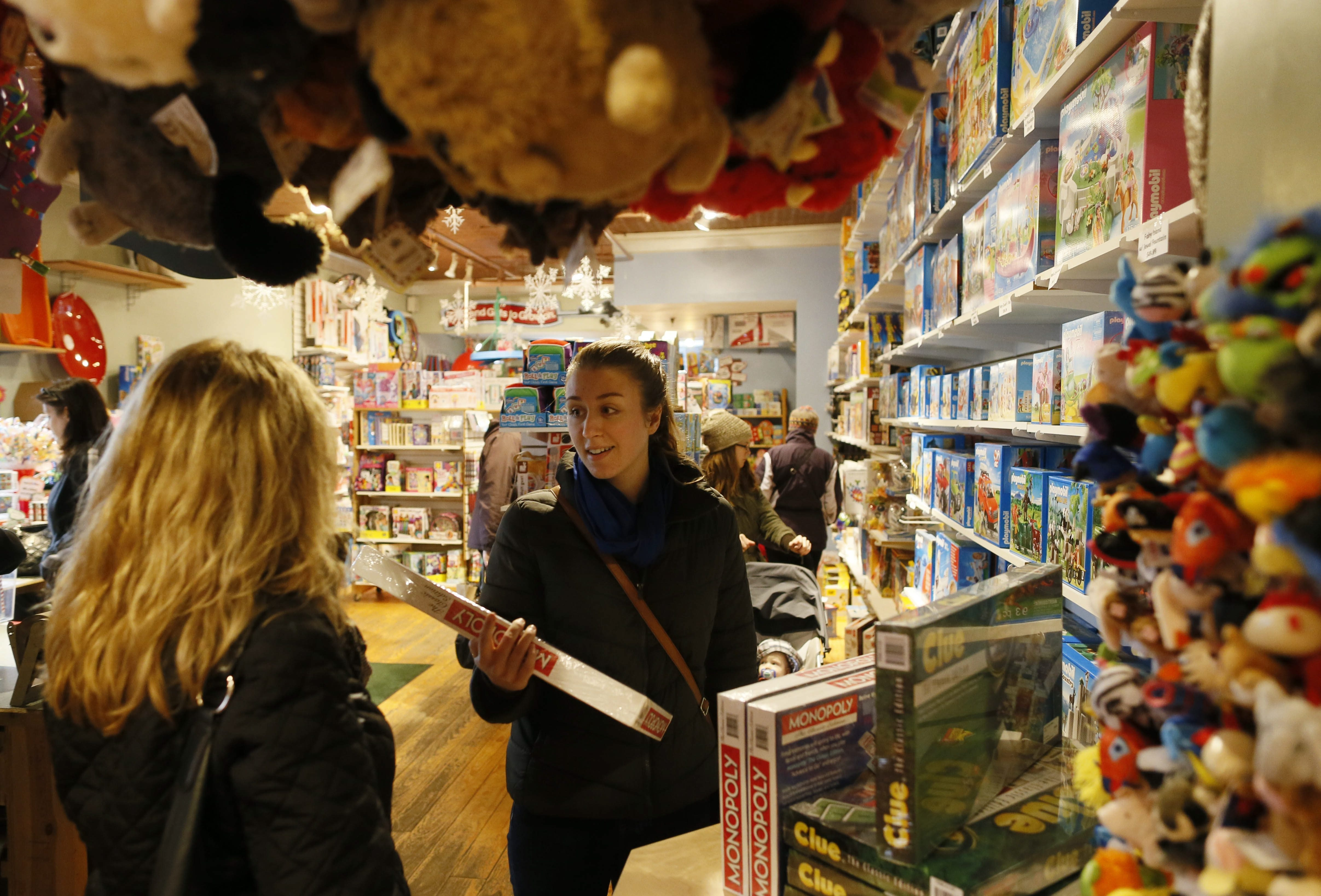 Samantha Geraci, right, and her mother, Valerie, of Tonawanda, shop at TreeHouse Toy Store.