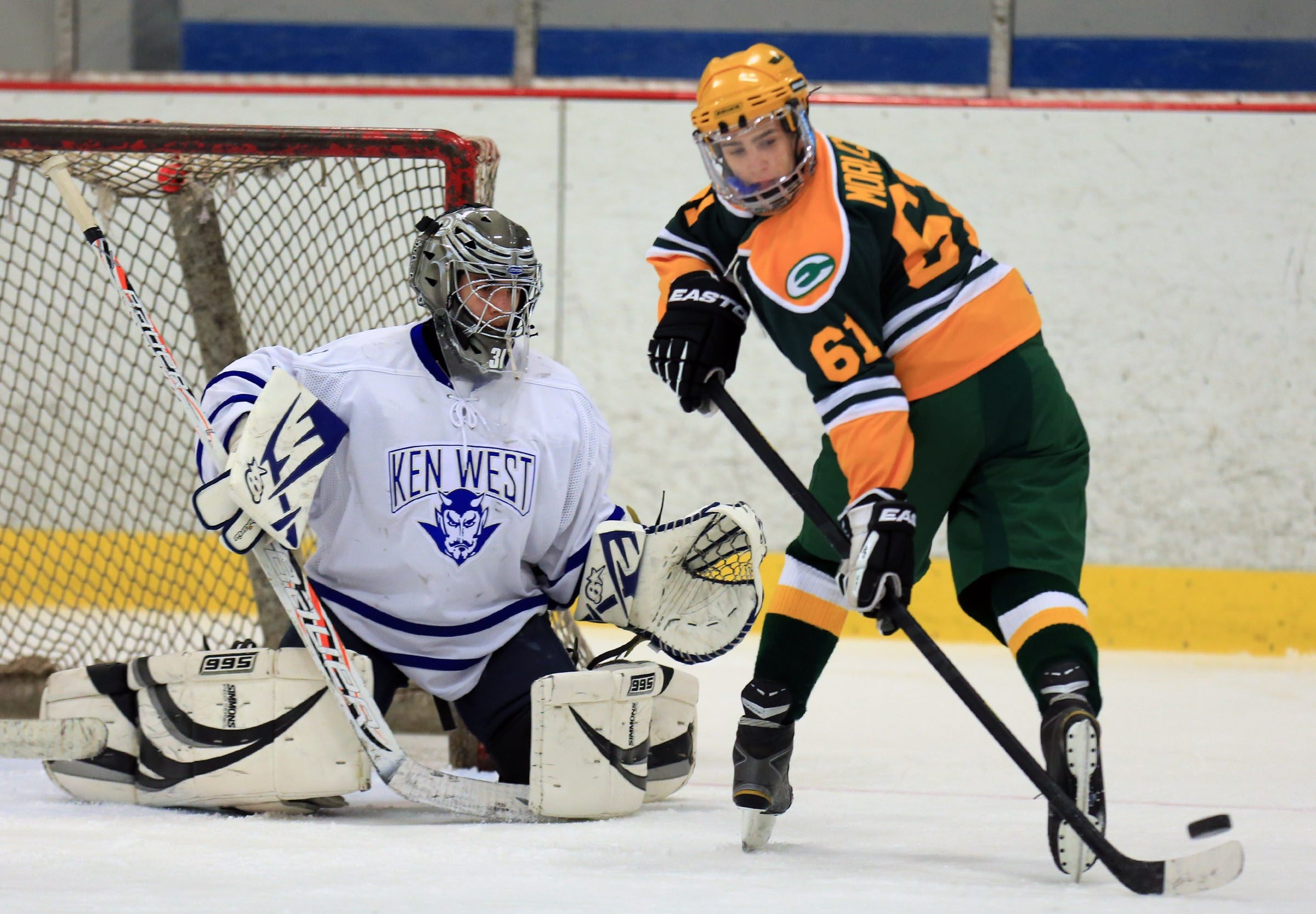 West Seneca East's Alex Morlock (61) finished with a goal and three assists as goalie Joseph Carney and his Kenmore West teammates dropped a 7-1 decision at the Hyde Park Ice Pavilion in Niagara Falls.