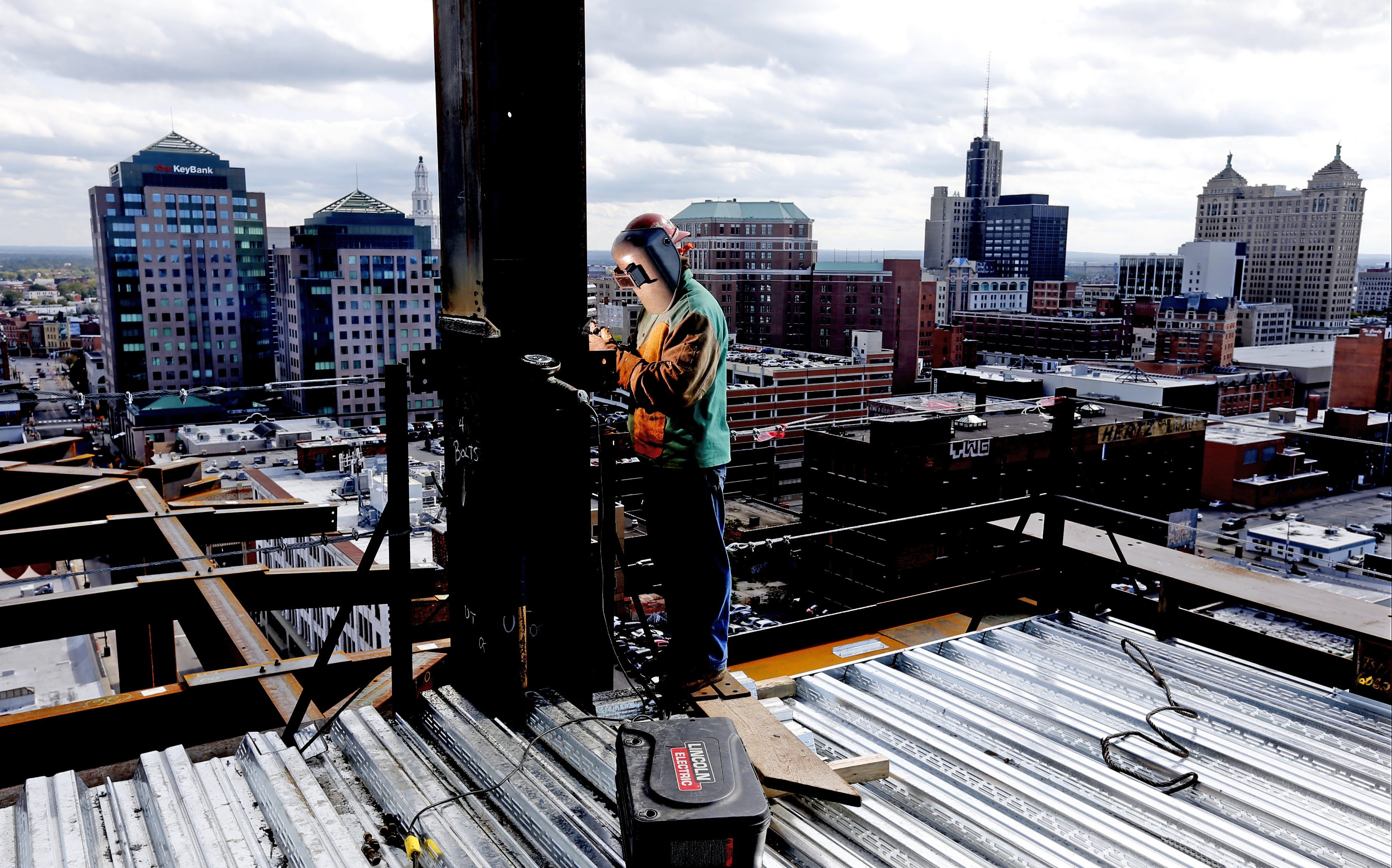 Jason Blasz welds a project on the 12th floor at 250 Delaware Ave. future home of Delaware North and hotel space on Monday, Oct. 6, 2014.  (Robert Kirkham/Buffalo News)