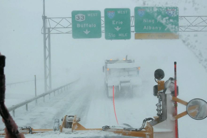 Plow drivers clear the Kensington Expressway during the first of two 2014 Buffalo blizzards on Tuesday, Jan. 7, 2014. (Sharon Cantillon/Buffalo News)