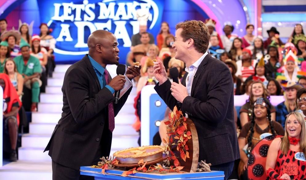 'Let's Make a Deal' announcer Jonathan Mangum, right, talks to Tim O'Shei about improv, Wayne Brady's ascent. (Monty Brinton/CBS)