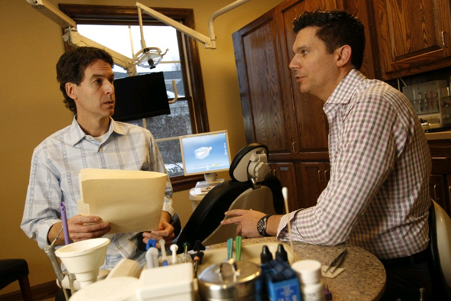 Drs. Mark S. Wendling, left, and David Rice, of East Amherst Dental Center, say they see more patients pay higher out-of-pocket expenses in today's dental insurance climate. (Sharon Cantillon/Buffalo News)