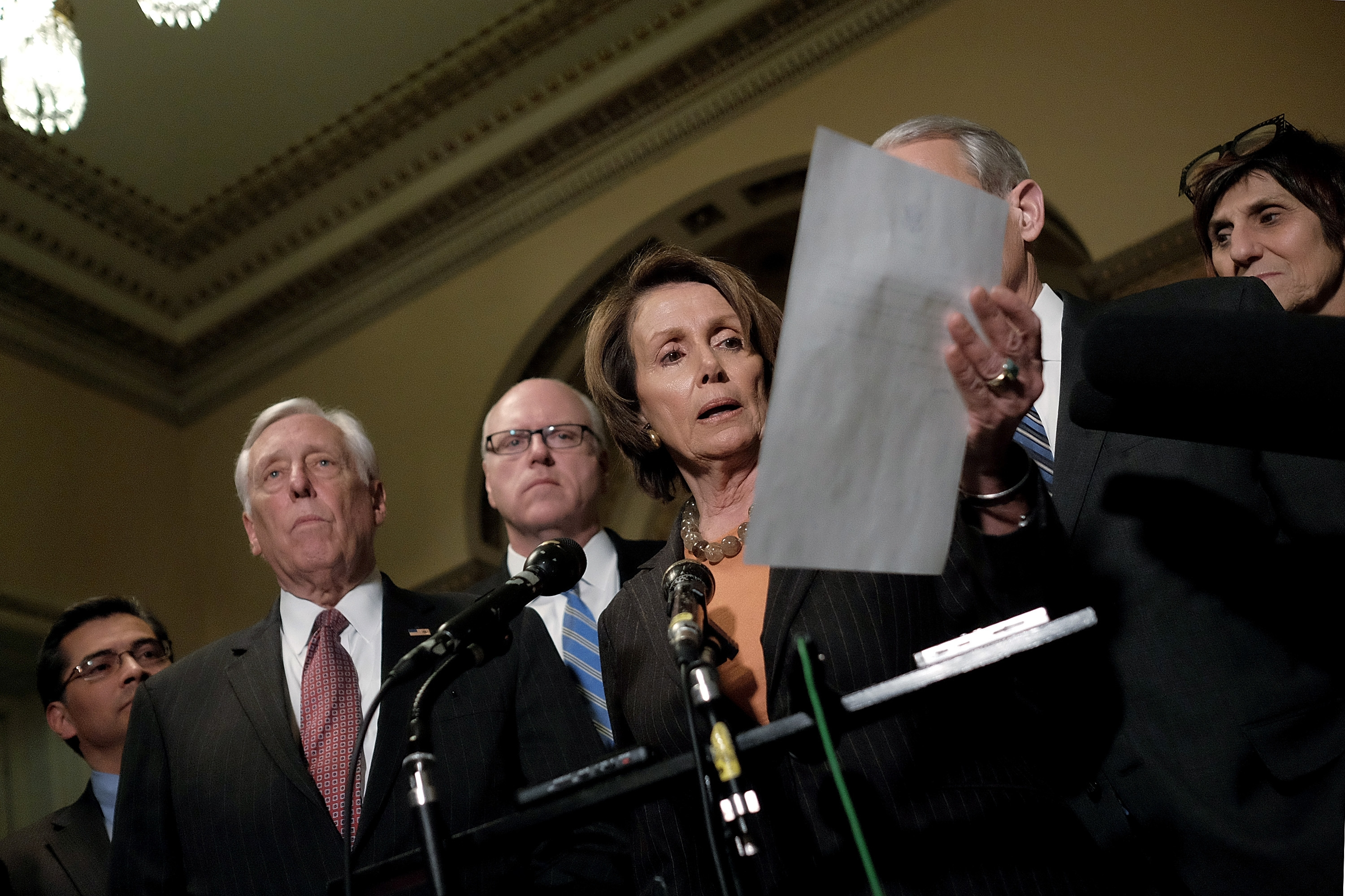 WASHINGTON, DC - FEBRUARY 27: House Minority Leader Rep. Nancy Pelosi (D-CA), at center, reads a letter she sent to colleagues in congress, urging support for a DHS stopgap funding bill, during a news conference with Democratic leaders including, from left, Rep. Xavier Becerra (D-CA), Rep. Steny Hoyer (D-MD), Rep. Joseph Crowley (D-NY) and Rep. Rosa DeLauro (D-CT) at the U.S. Capitol on February 27, 2015 in Washington, DC. The House failed earlier today to pass a 20-day stopgap bill to fund the Department of Homeland Security, after previous Senate and House versions of DHS funding bills were rejected by the other chamber, threatening to shut down the deparment with no clear resolution. (Photo by T.J. Kirkpatrick/Getty Images)
