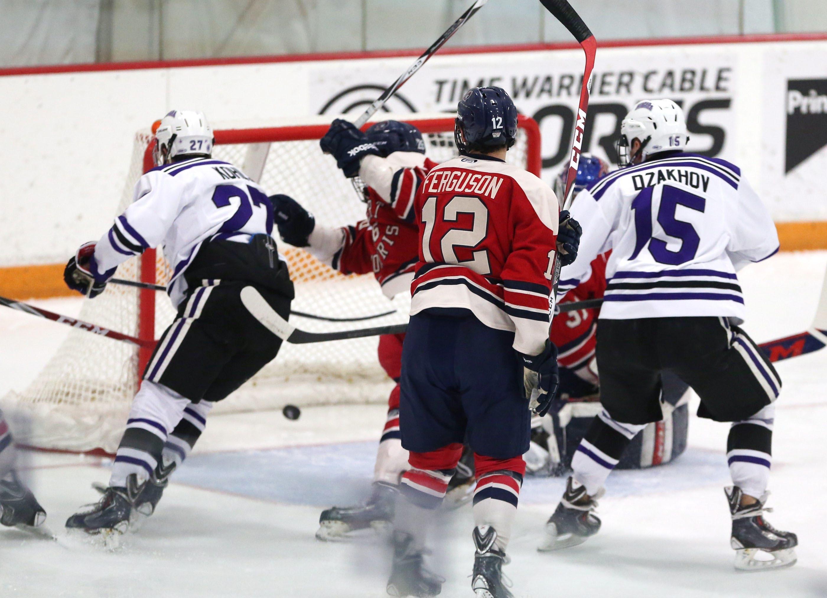 Niagara's Isaac Kohls scores one of his two goals against Robert Morris netminder Dalton Izyk.