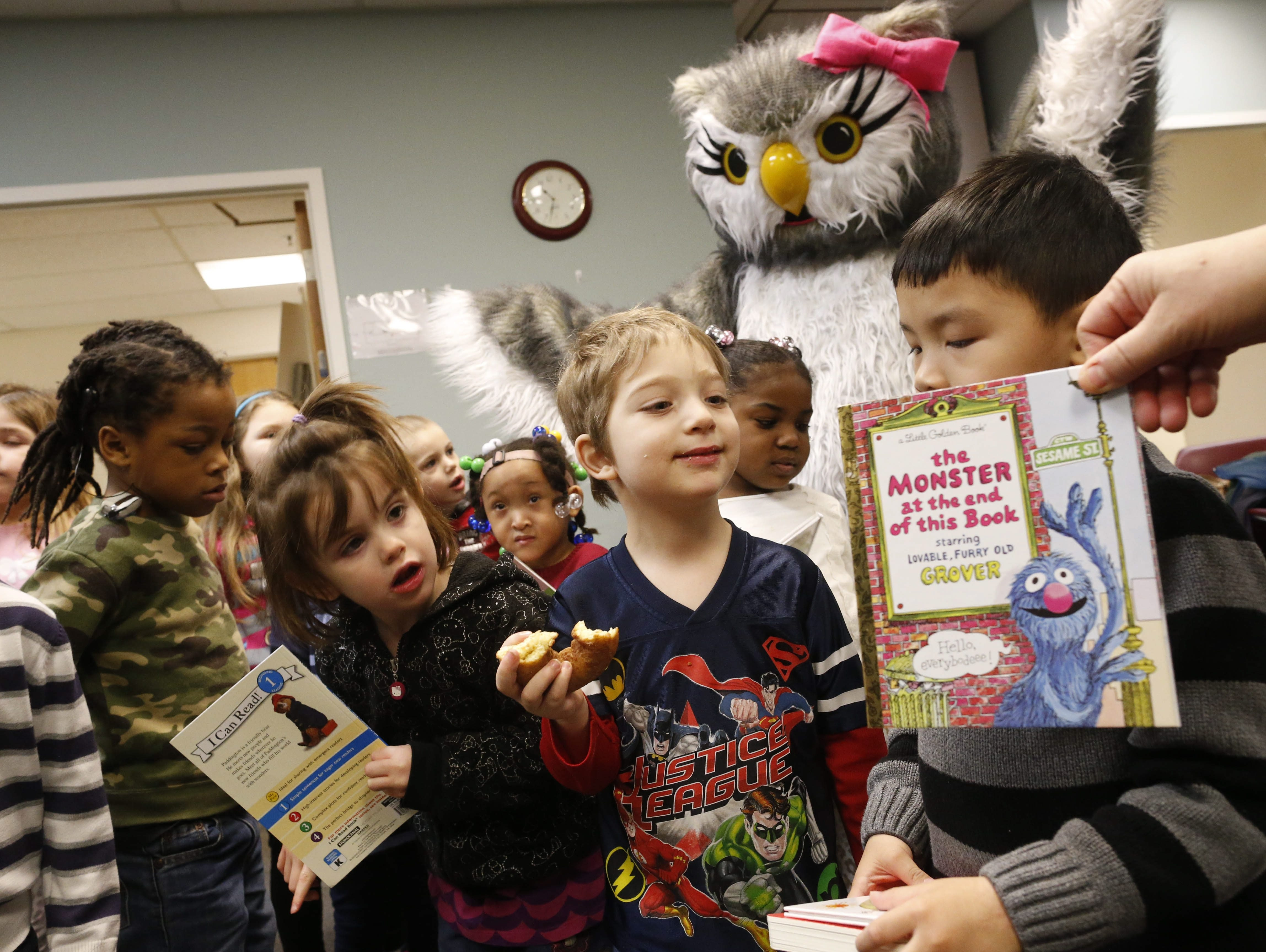 Children in the early childhood program at the Buffalo Hearing & Speech Center get new books during the kickoff of the annual Books for Kids campaign on Friday morning.