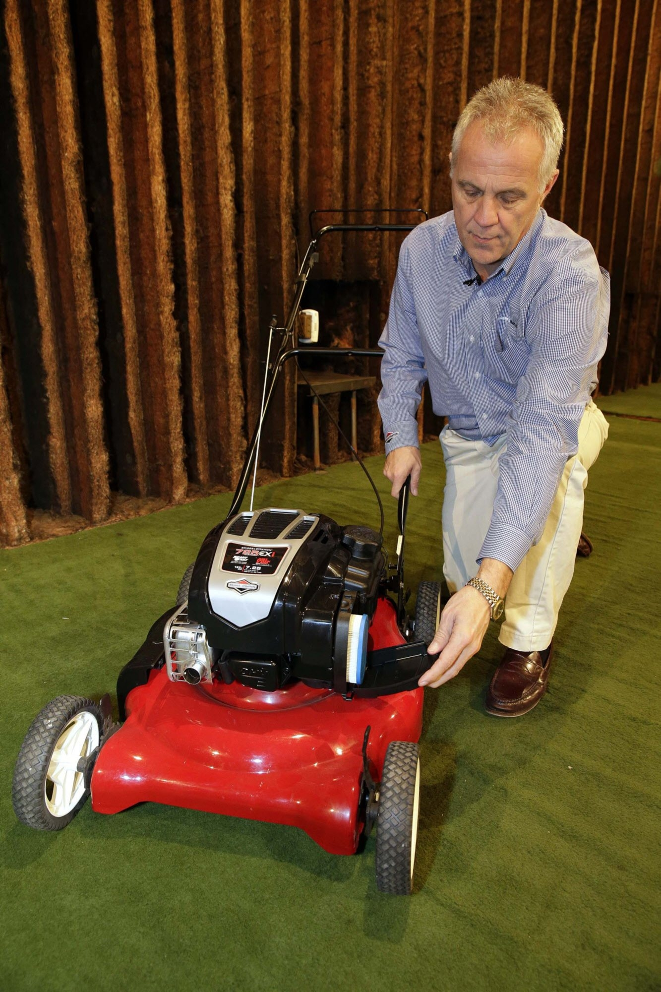Rick Zeckmeister, vice president of marketing and planning at Briggs & Stratton, shows the features of the industry's first small four-stroke gasoline engine.