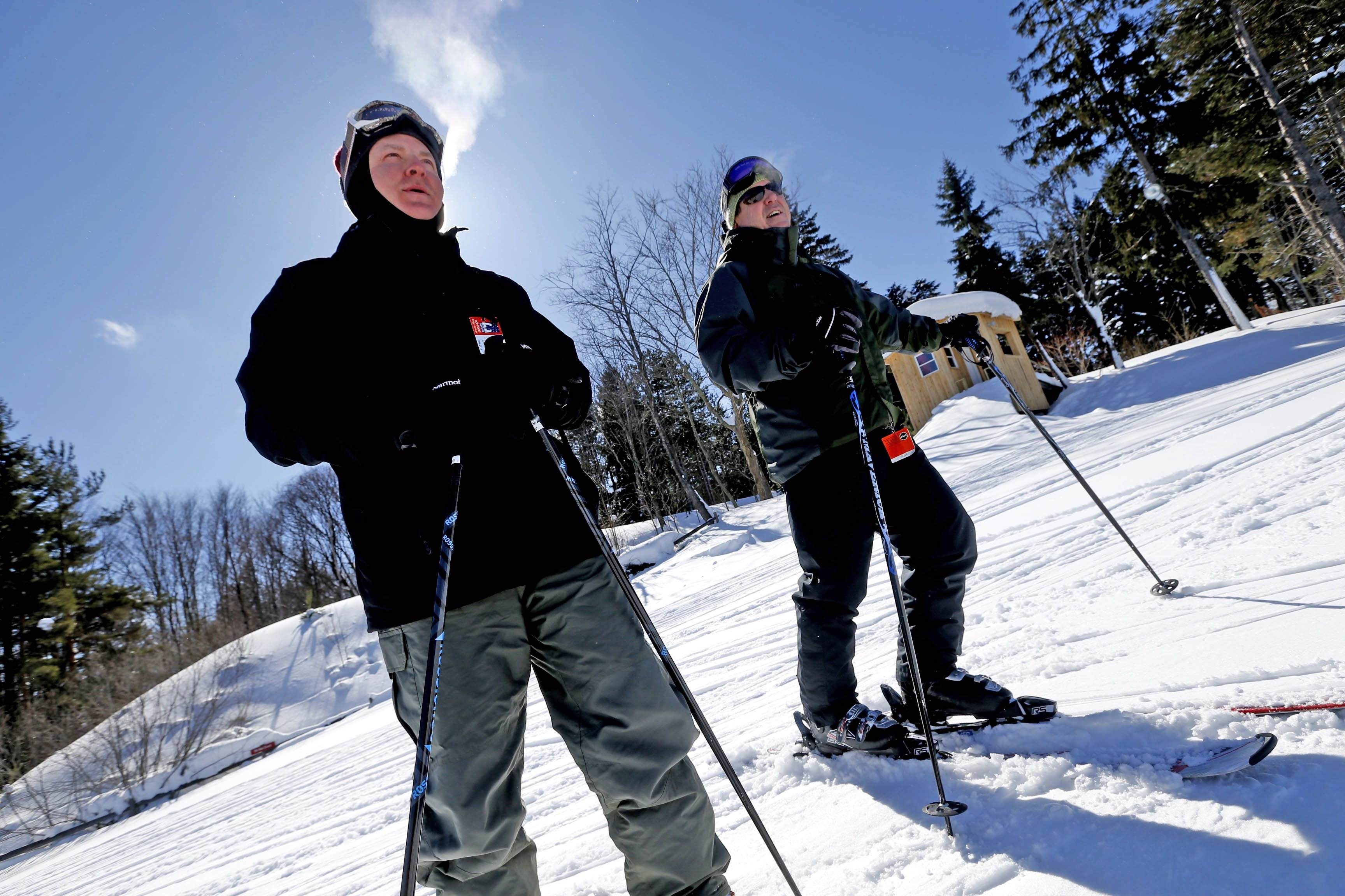 Sean Honan, left, of Amherst, and Bill Gallagher, of Buffalo, enjoy the near-perfect conditions at Buffalo Ski Club on Wednesday.