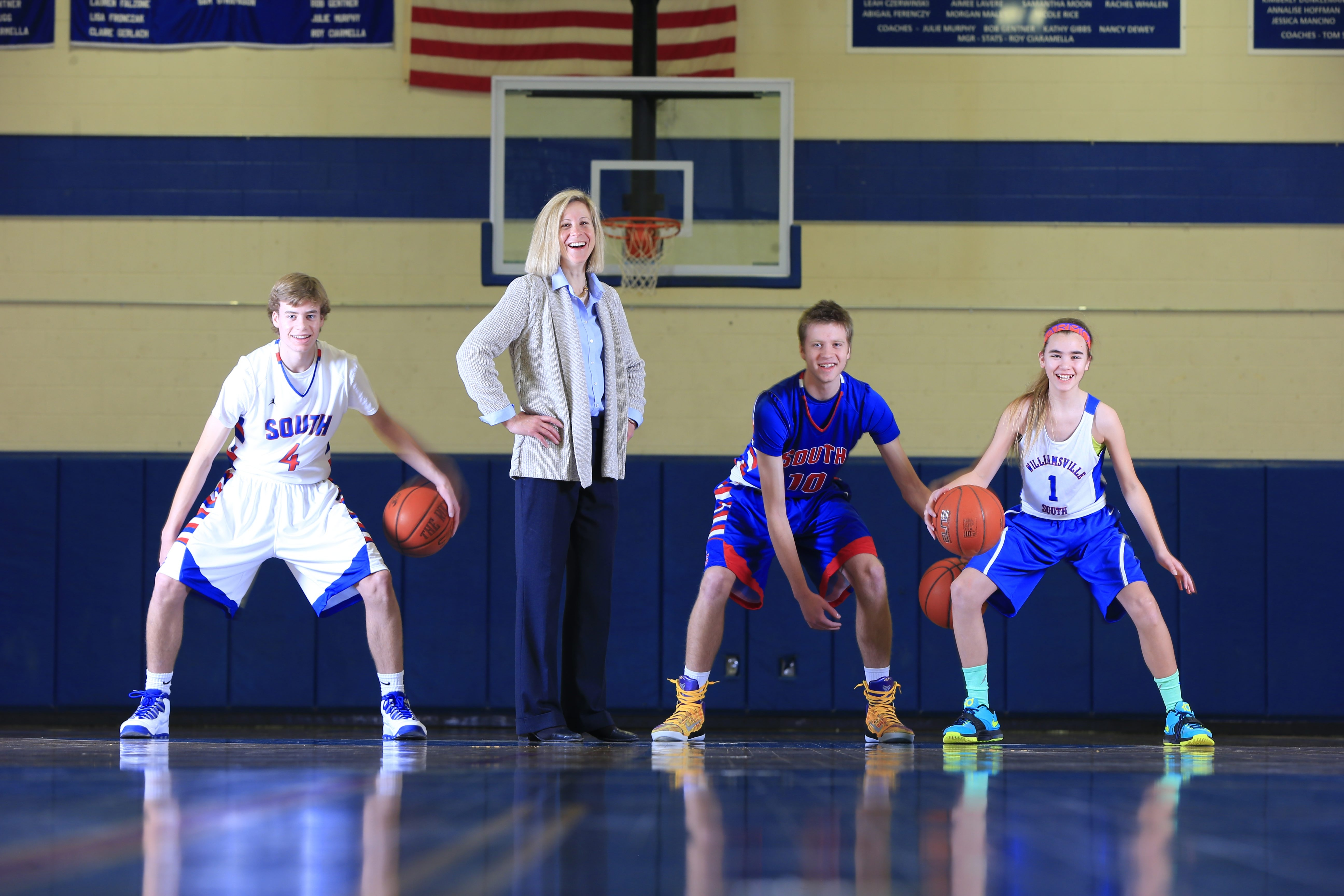 Williamsville South girls varsity basketball coach Kristen Dolan and her sons Greg (in white), Graham (in blue) and daughter Hannah.