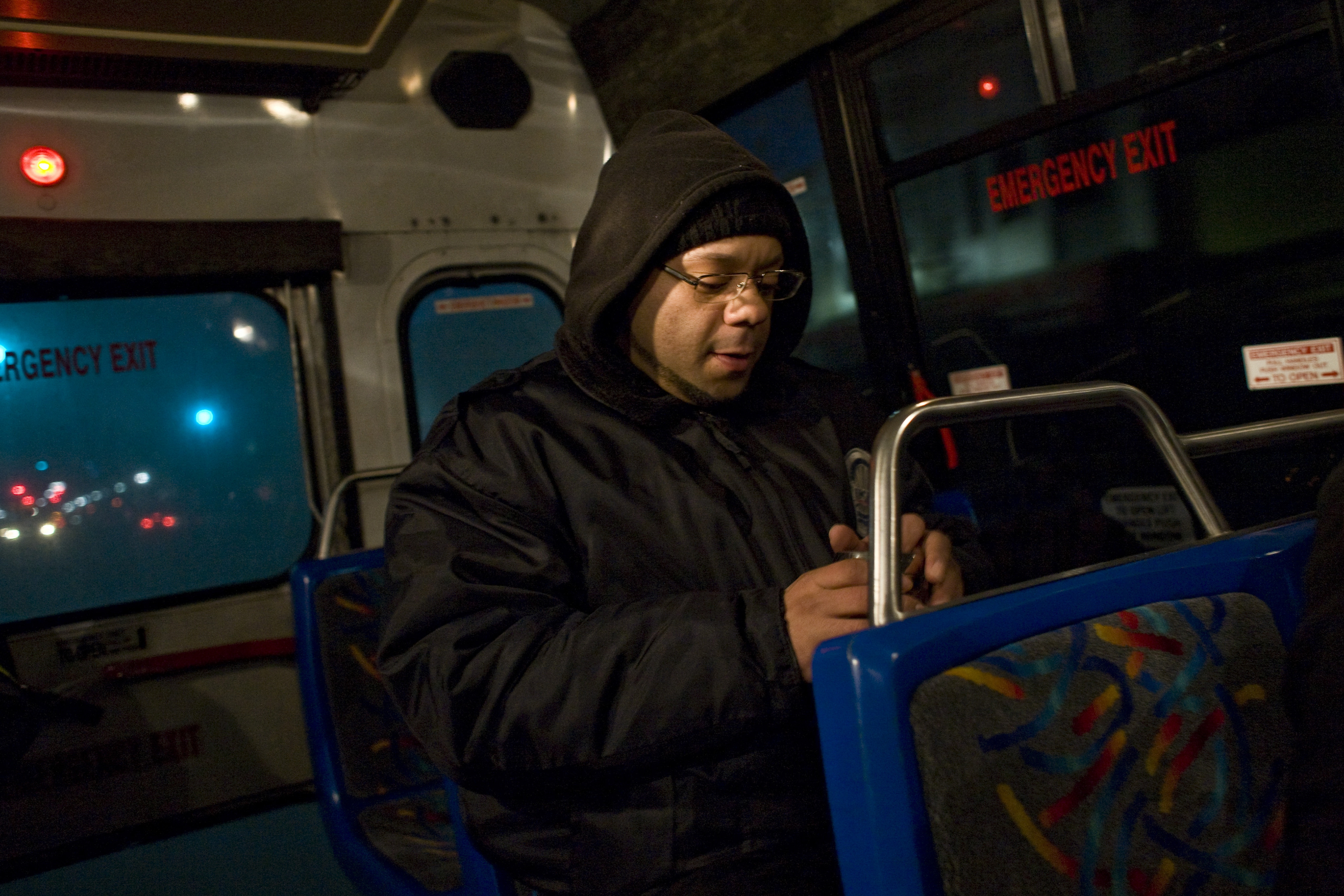 """Ramsey Montanez rides a bus to get to his 12-hour shift as a security guard in North Bergen, N.J. Montanez, a community college student who often gets off work at 11 p.m. and returns at 7 a.m., is one of many Americans beleaguered by such """"clopening shifts""""– a widespread practice that some politicians are looking to curtail."""