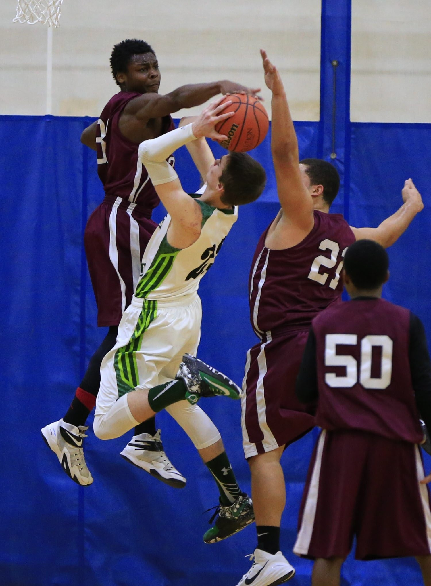 Lake Shore's Brandon Buchanan (22) has his shot blocked by Maryvale's Ted York-Brown (31) during Friday's game.
