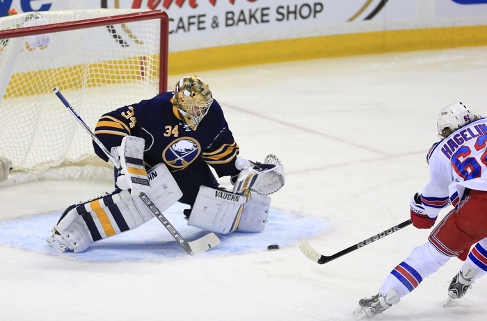 Buffalo goaltender Michal Neuvirth cannot stop the Rangers' Carl Hagelin from scoring in the first period at First Niagara Center. (Harry Scull Jr./Buffalo News)