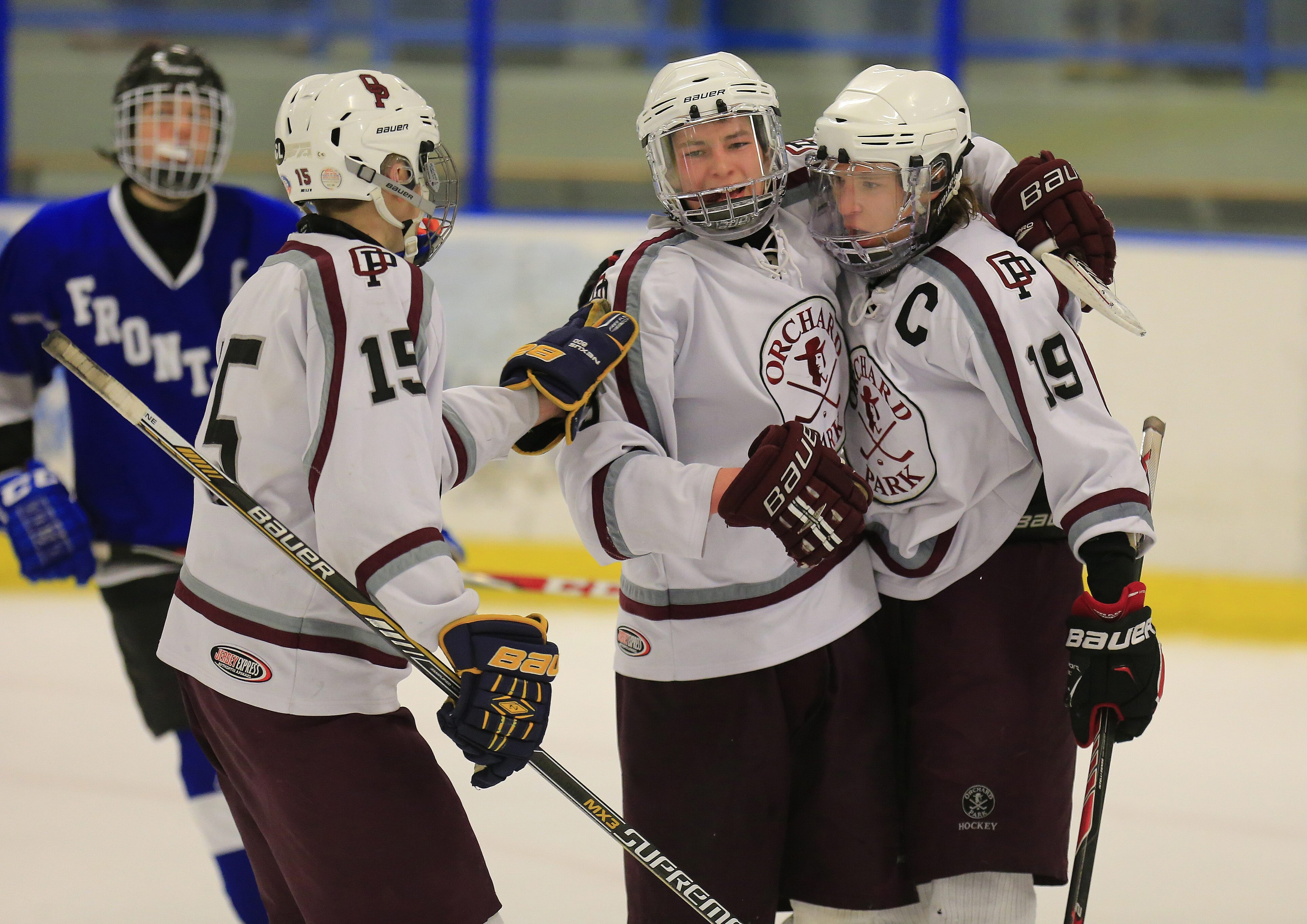 Orchard Park's  Jason Carey (15) and Mitchell Streety (3) congratulate Cole Schiffman (19) on his goal against Frontier during playoff action on Saturday.