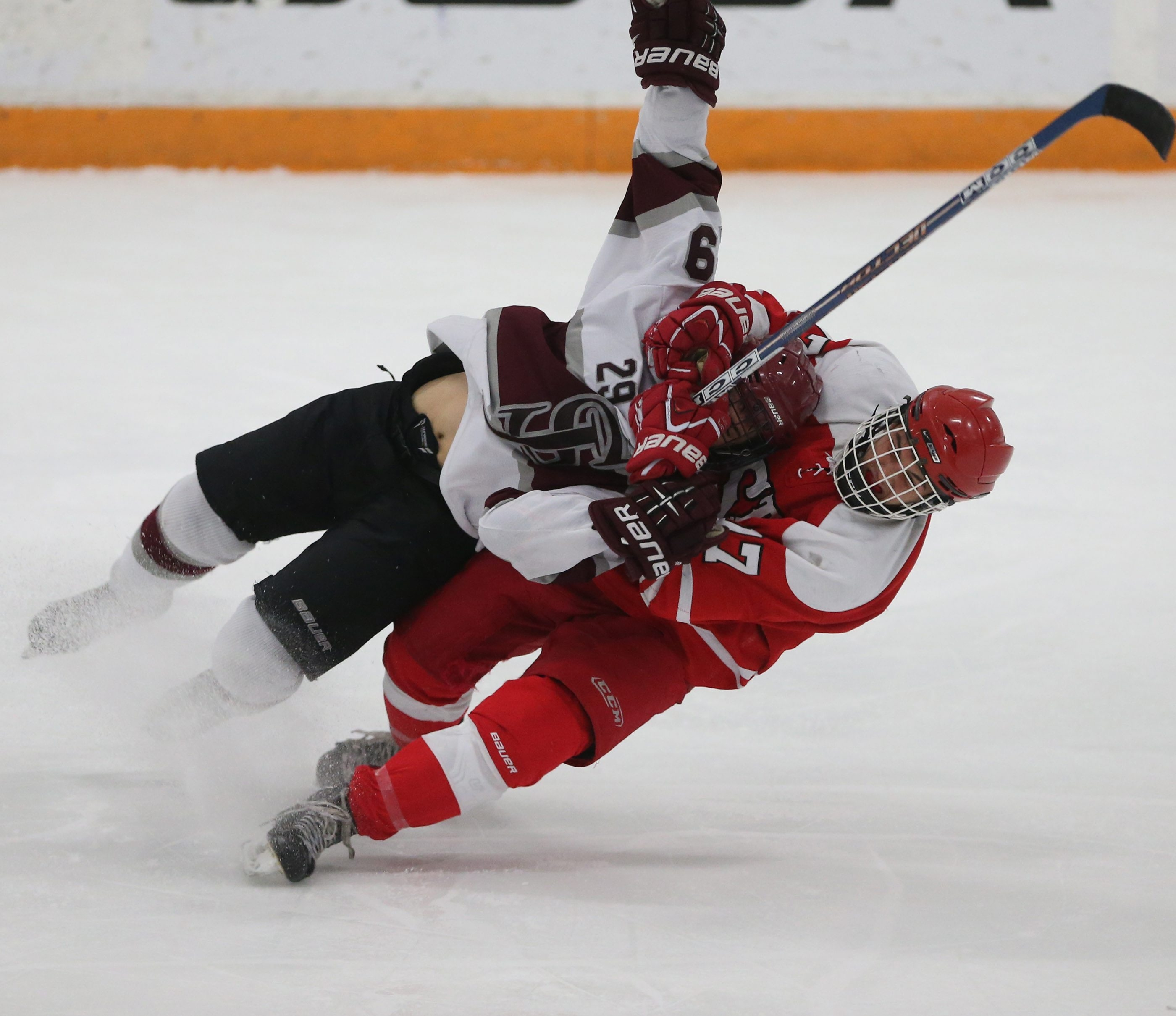St. Joe's Nash Braun gets taken down in a head lock by St. Francis' Christian Vidal in the third period in the Niagara Cup semifinal game at Dwyer Arena in Niagara University,N.Y. on Monday, Feb. 23, 2015.  (James P. McCoy/ Buffalo News)
