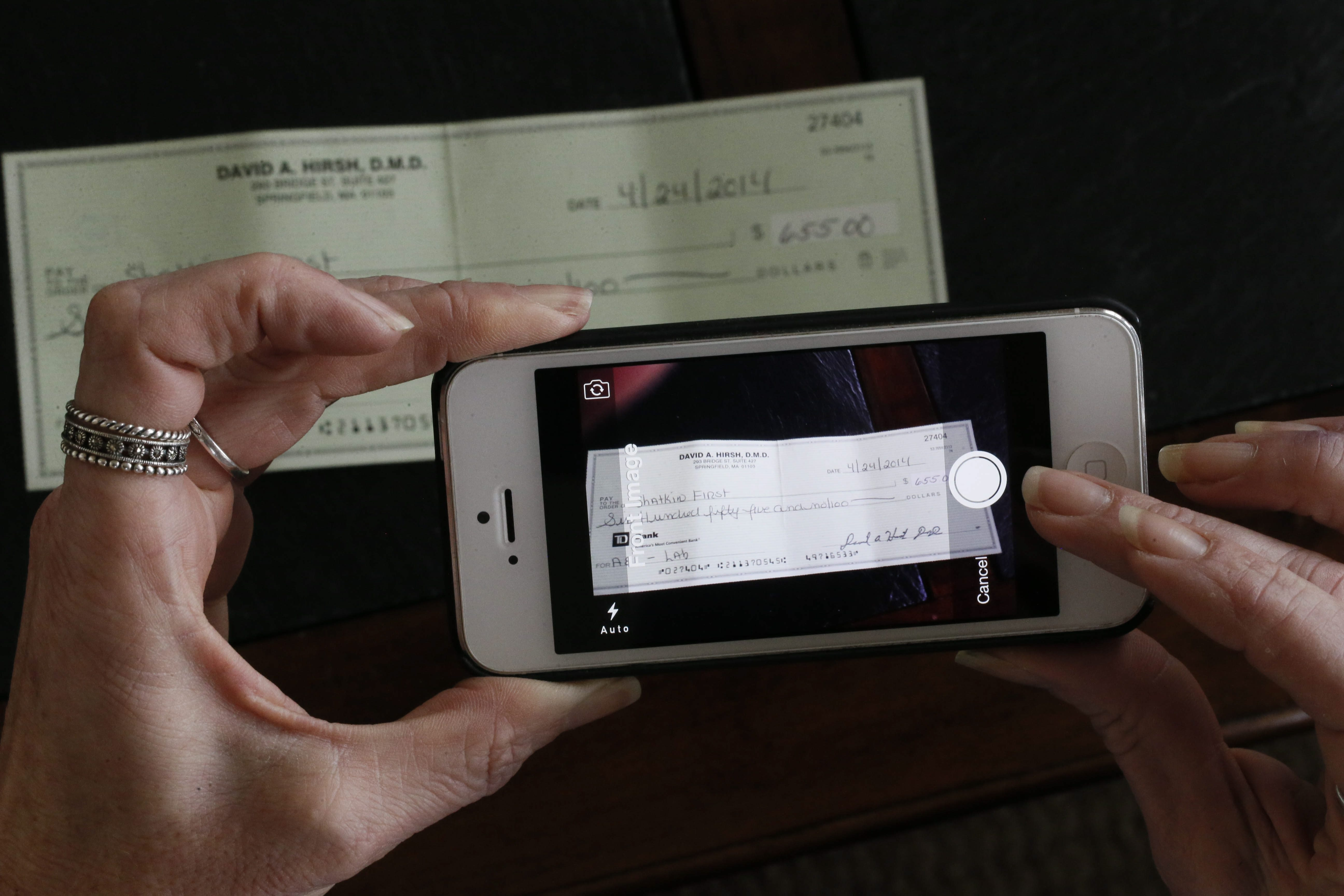 About 15 percent of adults with bank accounts used mobile remote deposit capture by year-end 2014.