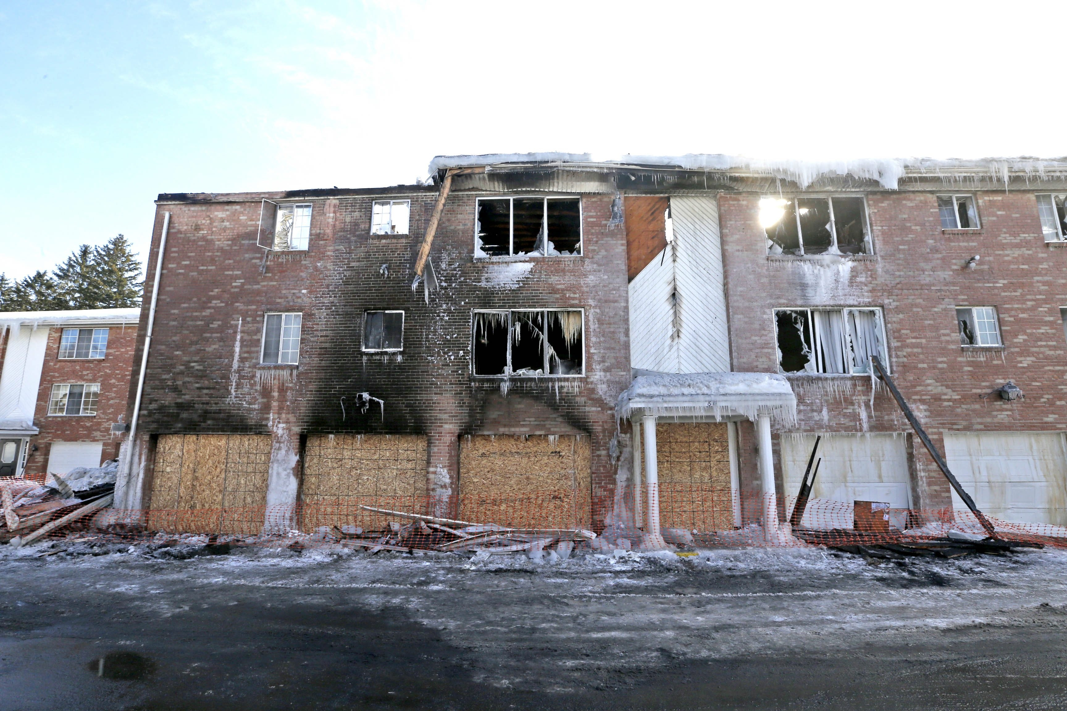 The rear view of 60 North Lake Lane, at the Green Lake apartments in Orchard Park was still standing, but barely the day after fire gutted the dwelling Monday, Feb. 16, 2015.  (Robert Kirkham/Buffalo News)