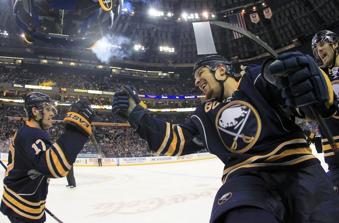 Chris Stewart, right, fist-taps Torrey Mitchell after Mitchell's second goal of the game proved to be the game-winner for the Sabres. (Harry Scull Jr./Buffalo News)