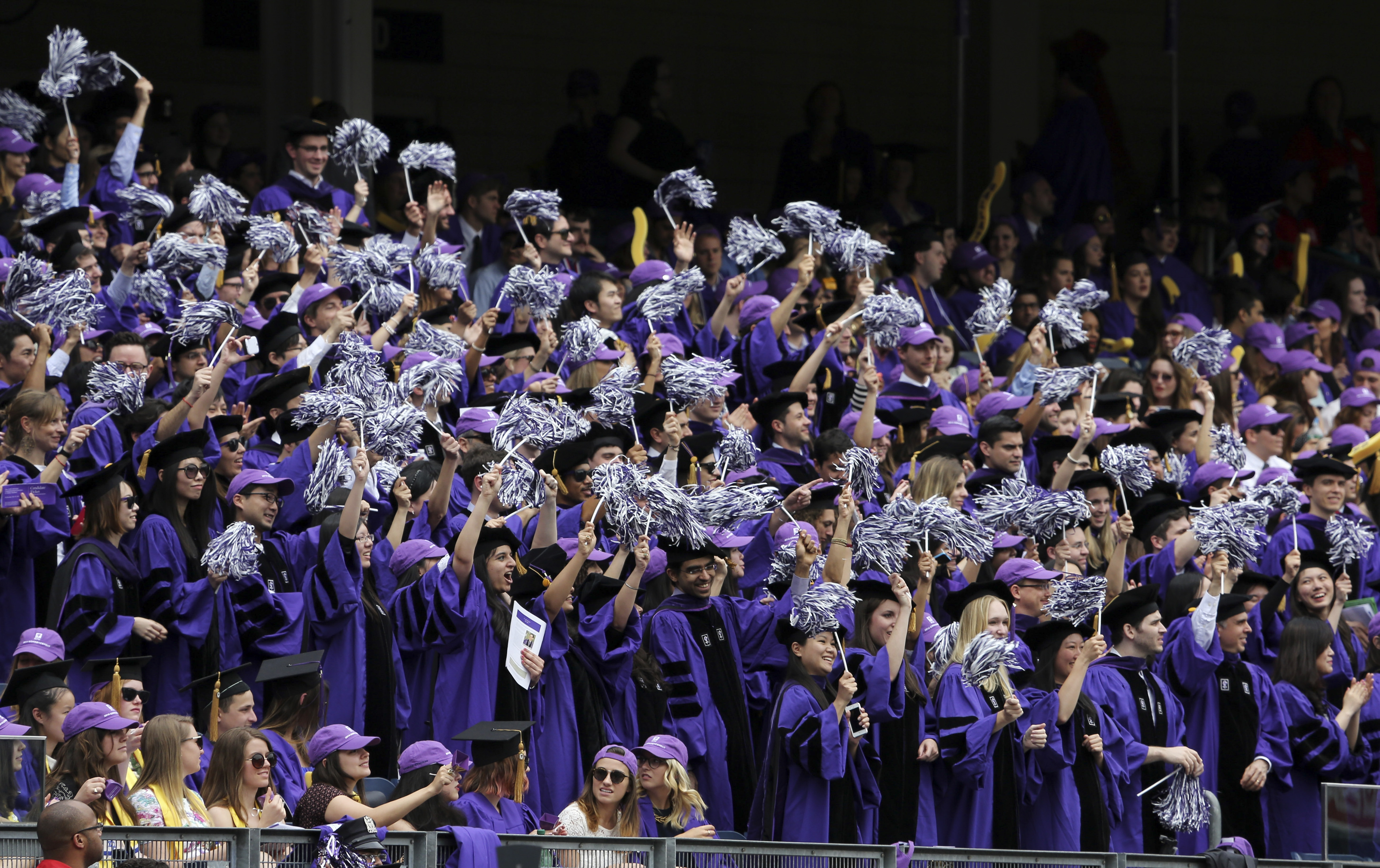 FILE -- New York University students celebrate graduation at Yankee Stadium in New York, May 22, 2014. Student loans recently surpassed credit cards as the third-largest form of household debt.  (Richard Perry/The New York Times) -- PHOTO MOVED IN ADVANCE AND NOT FOR USE - ONLINE OR IN PRINT - BEFORE JUNE 15, 2014.