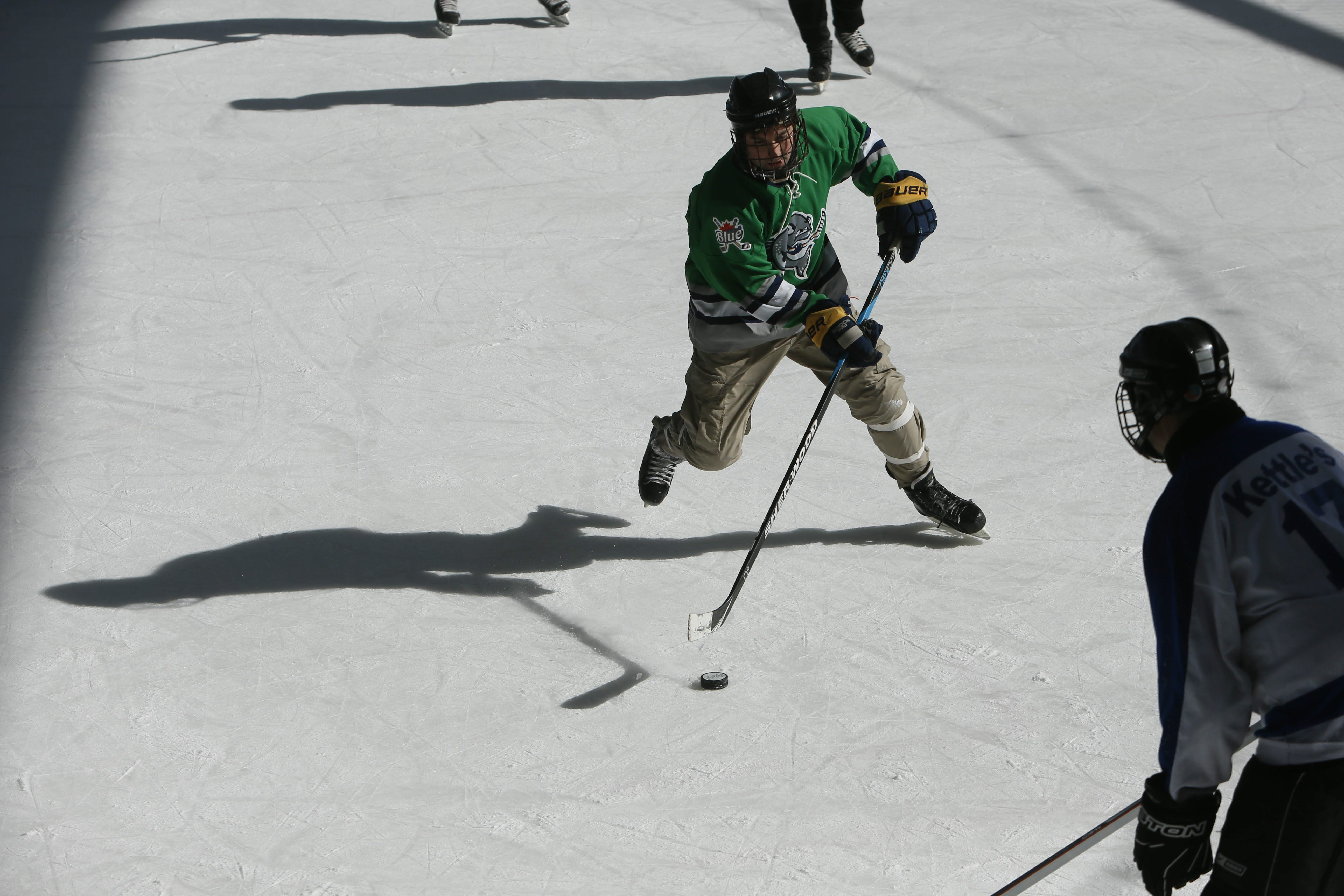 Trout Deux plays against Kettles Wings on the opening day of the Labatt Blue Buffalo Pond Hockey Tournament is underway at Buffalo RiverWorks, Feb. 20, 2015.  (Derek Gee/Buffalo News)
