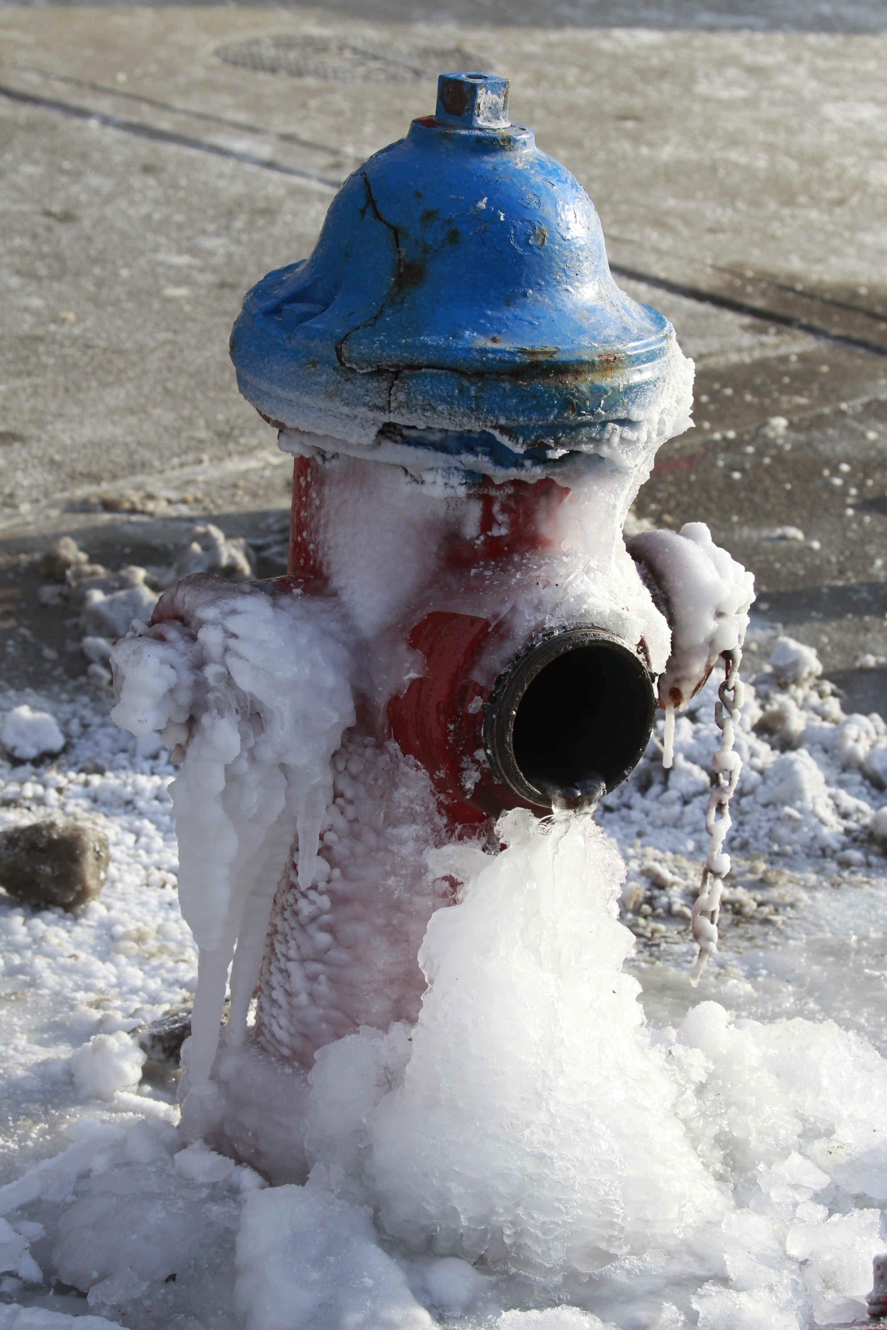 Frozen fire hydrant after a two alarm fire on the 15th floor of Main Place Tower in Buffalo, N.Y. on  Friday, Feb. 20, 2015.   (John Hickey/Buffalo News)