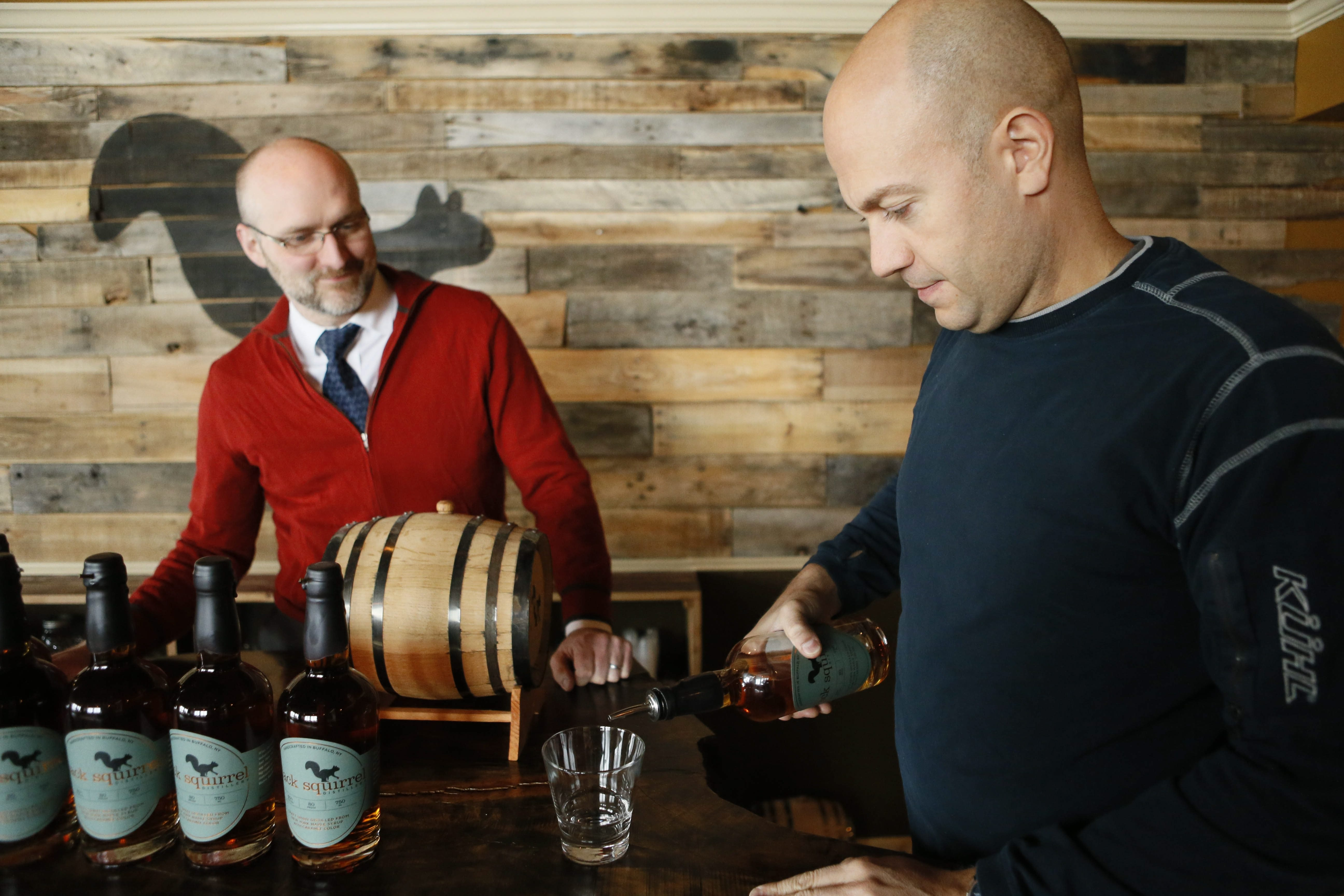 Brian Fending, left, and Jason Schwinger founded Black Squirrel Distillery on Elmwood Avenue, and are producing a craft spirit distilled from New York State maple syrup.