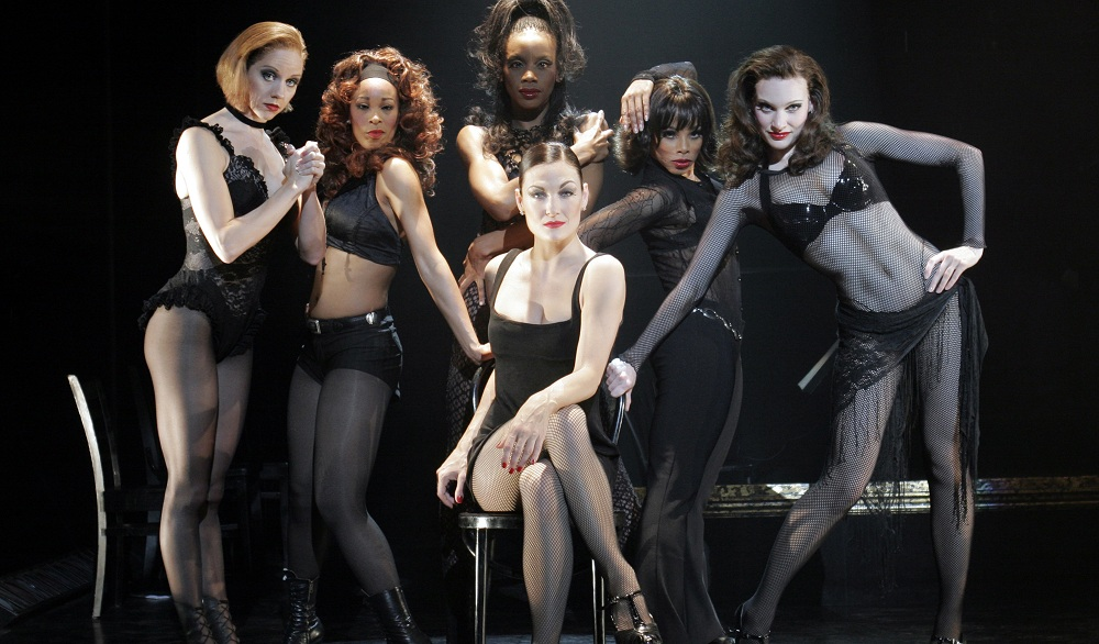 "Terra C. MacLeod, center,  stars as Velma Kelly in the touring production of ""Chicago,"" in Shea's Performing Arts Center through Sunday."