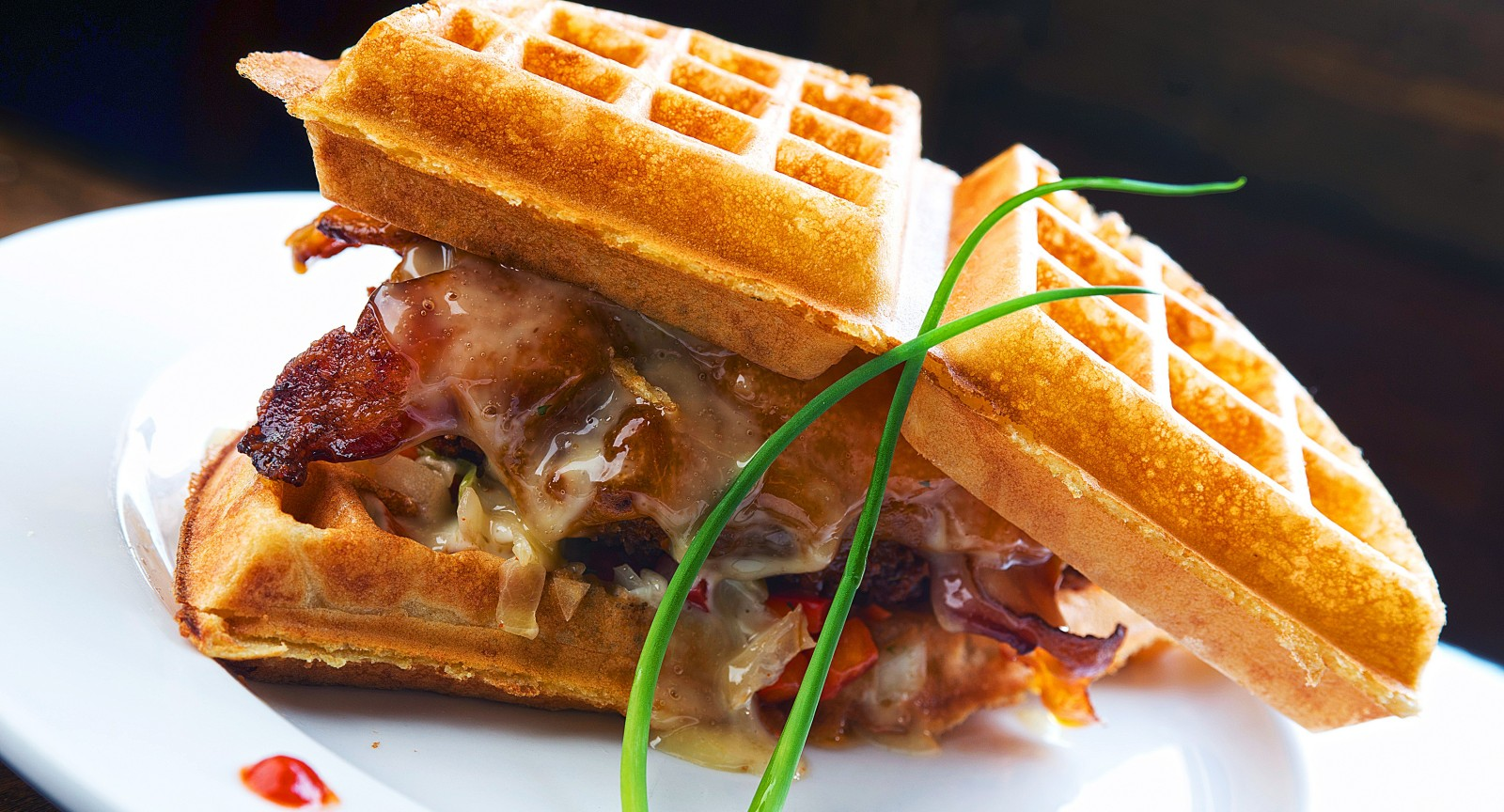 The Griffon Gastropub's chicken and waffle sandwich will be making its East Aurora debut in July, if all goes as planned.