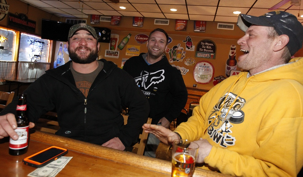 Mark Settlemyer, left,  Robert Mays and Jay Uzdek of Lancaster hang out at Longneckers on Walden Avenue in Lancaster, a fun neighborhood gathering place. (Photos by Sharon Cantillon/Buffalo News)