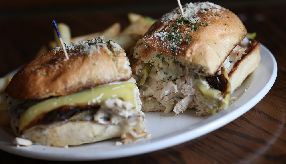 The Turkey Dibble features roasted turkey breast, stuffed banana peppers and mozzarella cheese served on a toasted garlic roll with fries. (Sharon Cantillon/Buffalo News)