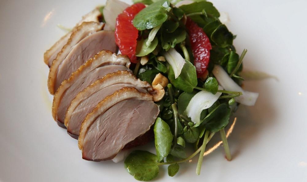 Smoke duck salad, made with cherry wood-smoked duck breast, blood orange, watercress, hazelnut and barrel-aged vinaigrette. (Sharon Cantillon/Buffalo News)