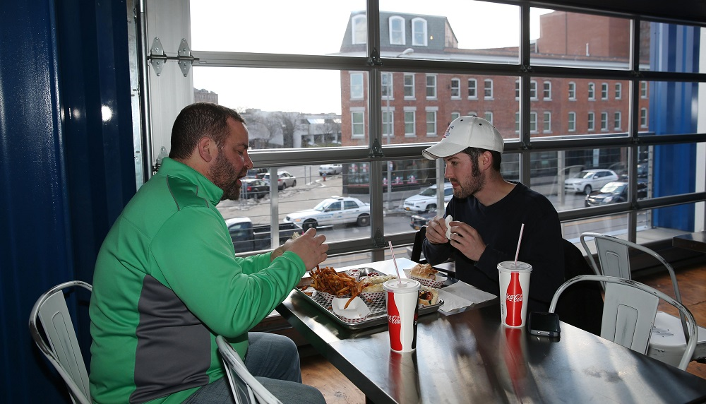 Jon Robare, left, and Corey Catalano have lunch in Dog é Style Bar & Grill. See buffalonews.com for more photos. (Sharon Cantillon/Buffalo News)