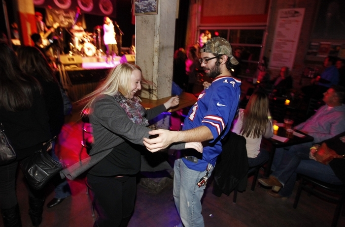 Miranda John and Scott Scheffler dance to live music at Buffalo Iron Works. (Sharon Cantillon/Buffalo News)