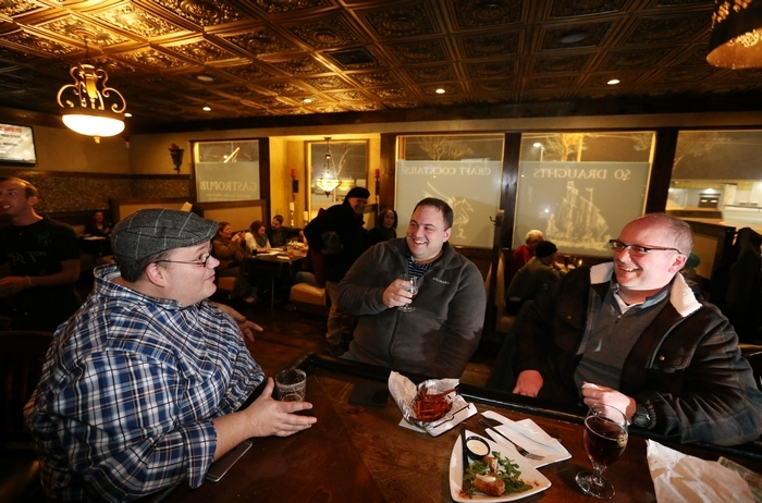 Kevin Wise, left, of Cheektowaga, Ryan Allen of the Town of Niagara and Darren Carson of the Town of Tonawanda enjoy beer and snacks. More photos at www.buffalonews.com. (Photos by Sharon Cantillon/Buffalo News)