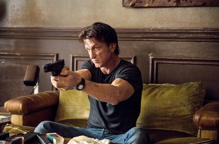 Sean Penn plays a gun-toting international aid worker in 'The Gunman.'