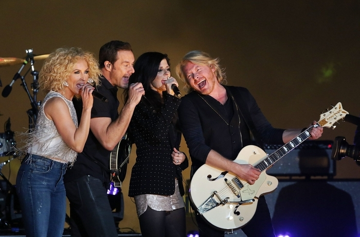 Members of the band Little Big Town, from left, Kimberly Schlapman, Jimi Westbrook, Karen Fairchild and Phillip Sweet, perform at halftime of the Capital One Orange Bowl. (Getty Images)
