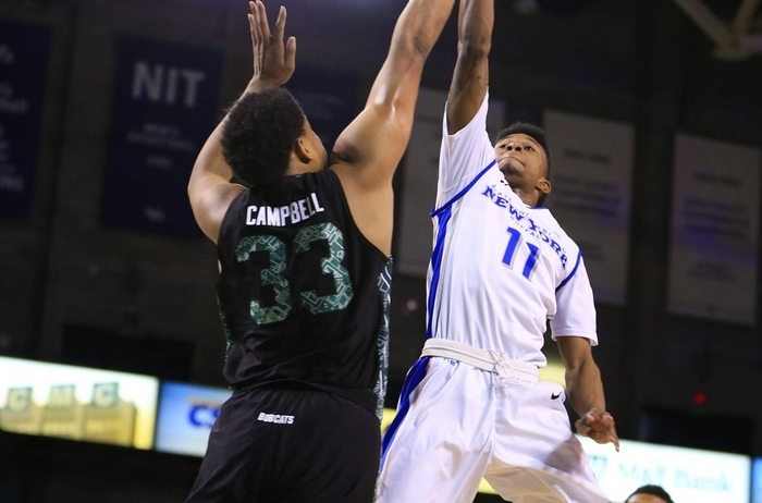 Buffalo's Shannon Evans drives to the basket against Ohio's Antonio Campbell, helping UB to its fifth straight win on Tuesday. (Harry Scull Jr./Buffalo News)