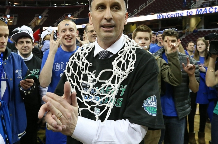 Buffalo Bulls head coach Bobby Hurley cuts down the net after beating the Central Michigan Chippewas 89-84 to win the 2015 MAC Men's basketball Championship at Quicken Loans Arena in Cleveland,Ohio on Saturday, March 14, 2015.  (James P. McCoy/ Buffalo News)