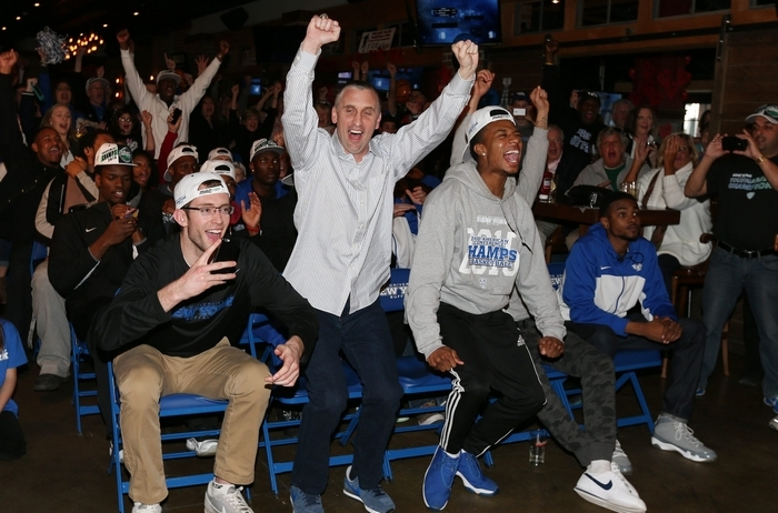 Buffalo Bulls head coach Bobby Hurley and his team react to their NCAA bracket while watching the selection show on TV at Santora's Pizza Pub in Clarence on Sunday, March 15, 2015.  (James P. McCoy/ Buffalo News)