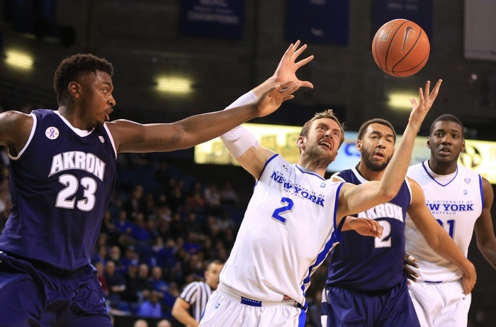 Buffalo player Will Regan (2) and Akron's Isaiah Johnson (23) battle for a rebound during first half action at Alumni Arena on Tuesday, Feb. 24, 2015.(Harry Scull Jr./Buffalo News)