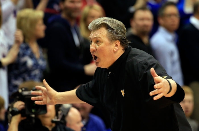 West Virginia coach Bob Huggins yells during a game at Kansas earlier this month. Based on Jerry Sullivan's history of picking against Buffalo teams, this might make for an apt reaction for Sully picking the Mountaineers against UB. (Getty Images)