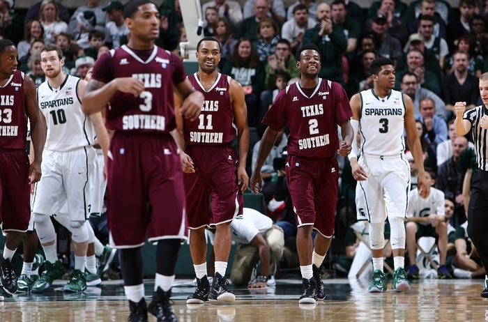 Malcolm Riley (11) and Chris Thomas (2) of Texas Southern celebrate during the Tigers' overtime win at Michigan State in December. (Getty Images)