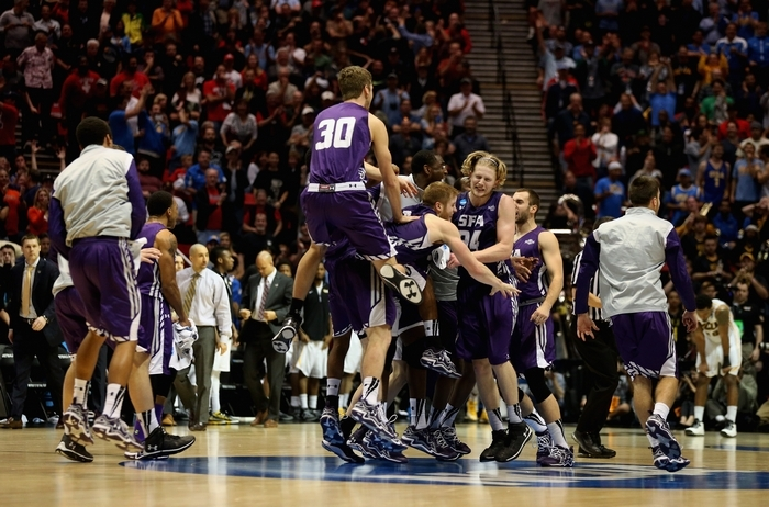 Jacob Parker (34), Thomas Walkup (0) and Tanner Clayton (30) of Stephen F. Austin celebrate the Lumberjacks' 77-75 overtime victory over Virginia Commonwealth in last year's NCAA Tournament. (Getty Images)