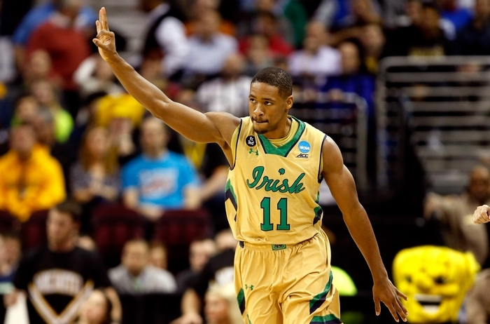 Demetrius Jackson holds up three fingers after sinking a big three-pointer to help Notre Dame regain its lead in the first half. (Getty Images)