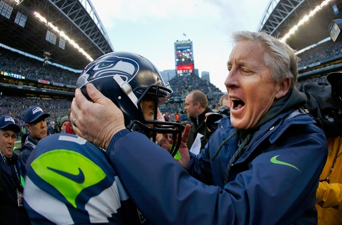 Russell Wilson and the Seahawks have responded to Pete Carroll's coaching style. (Getty Images)