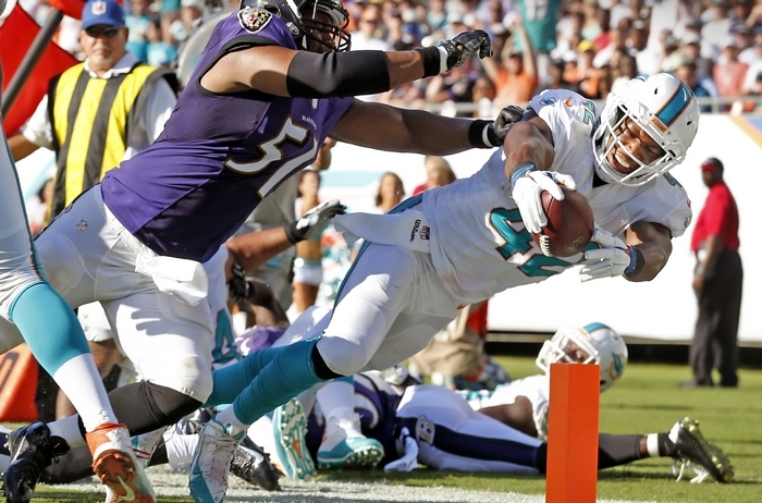 An NFL source says the Miami Dolphins might still be negotiating to keep tight end Charles Clay, who the Bills have been pursuing. (Tribune News Service)